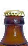 Isolated bottleneck. An isolated bottleneck of a bottle of beer stock photo