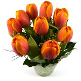 An isolated bouquet of colorful tulips on a vase of glass Royalty Free Stock Images