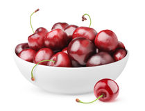 Isolated bowl of cherries. Isolated cherries. Pile of sweet cherry fruits in ceramic bowl isolated on white background with clipping path Royalty Free Stock Images