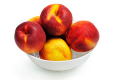 Isolated bowl with nectarine Stock Photography