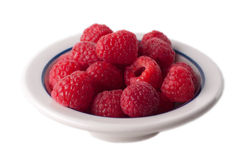 Isolated bowl of raspberries. Fresh raspberries in a bowl in a studio Stock Images