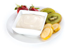 Isolated bowl of yogurt with fresh strawberries, kiwi and banana Stock Photography