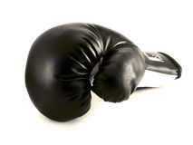 Isolated boxing glove. One black boxing glove isolated over white Stock Photo