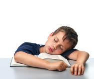 Isolated boy dreaming over thick book Royalty Free Stock Images
