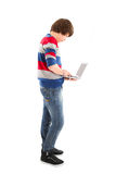 Isolated boy with laptop - always online Stock Photo