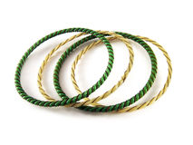 Isolated bracelets. Green and yellow bracelets isolated on white background Royalty Free Stock Photos