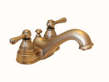 Isolated Brass Faucet. A brass bathroom faucet isolated on white Royalty Free Stock Image