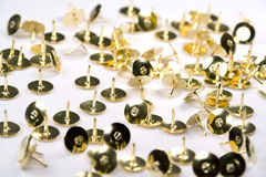Isolated brass tacks Royalty Free Stock Images