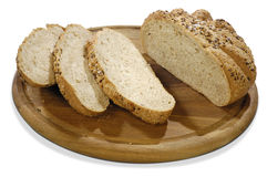 Isolated bread with grains on a board. Of sesame with clipping paths Stock Photo