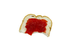 Isolated bread and strawberry jam with a bite Stock Photo