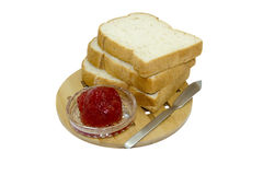 Isolated bread and strawberry jam on wooden plate Stock Photos