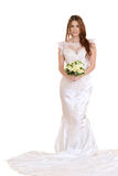 Isolated bride standing with bouquet Stock Photos