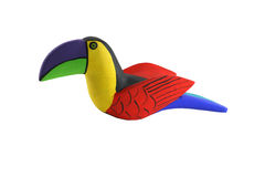 Isolated Brightly colored handcarved wooden toucan. A Isolated Brightly colored handcarved wooden toucan Royalty Free Stock Photos