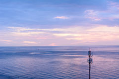 Isolated broadcast tower on the beach. Isolated broadcast tower on the beach in beautiful sunrise scenario Stock Image