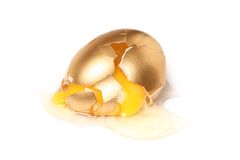 Isolated broken golden egg Royalty Free Stock Photo