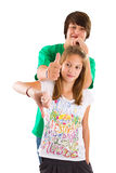 Isolated brother and sister thumbs up and down Stock Photo