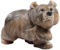 Isolated brown bear figurine made of stone Stock Images