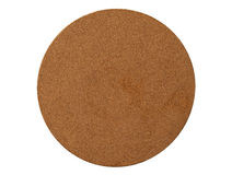 Isolated brown circle coaster corkboard pad. Isolated brown circle coaster cork board pad stock photos