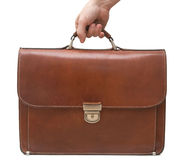 Isolated brown leather briefcase. Hand holding isolated brown leather briefcase Stock Images
