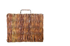 Isolated brown rattan suitcase on white Royalty Free Stock Photos