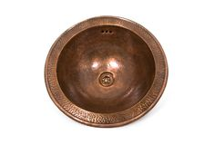 Dark copper round sink on white background. Isolated brown sink in retro style. Copper chasing. Isolated brown sink in retro style. Antique sink for home on royalty free stock photos