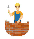 Isolated builder bricklayer. Isolated builder bricklayer with spatula and hard hat on white background Royalty Free Stock Photos