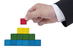 Isolated building blocks with hand Stock Images