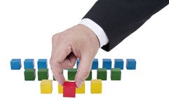 Isolated building blocks with hand Royalty Free Stock Photos