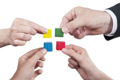 Isolated building blocks with hands Stock Photo