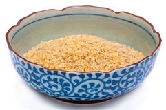 Isolated bulgur in blue plate Royalty Free Stock Images