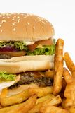 Isolated burger with fries Royalty Free Stock Image