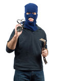 Isolated Burglar. Holding a crowbar and a flashlight stock images