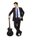 Business man with a black electric guitar Stock Photography