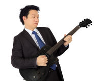 Business man with a black electric guitar Stock Photos