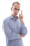 Isolated business man holding finger up in a blue shirt Royalty Free Stock Photo