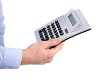 Isolated business man holding a pocket calculator in his hands. Royalty Free Stock Photos