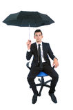 Isolated business man. Isolated young business man with umbrella stock images