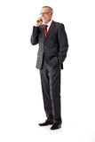 Isolated business senior man, standing and calling Stock Image