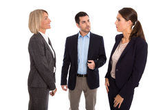 Isolated business team: man and woman talking together. Stock Photos