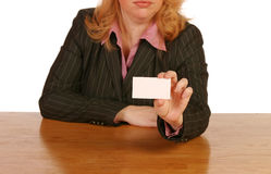 Isolated business woman. Holding a blank business card Stock Image