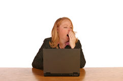Isolated business woman. Working on laptop yawning Royalty Free Stock Photo