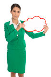 Isolated business woman in green holding a white placard. Royalty Free Stock Images