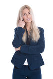 Isolated business woman has problems with her ears. Royalty Free Stock Images