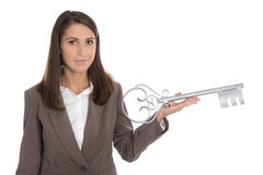 Isolated business woman holding key for a housewarming party in Stock Photos