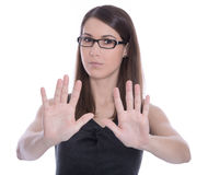Isolated business woman says stop - concept for bullying. Stock Photos