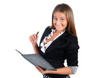 Isolated business woman. Isolated young business woman with notebook stock image