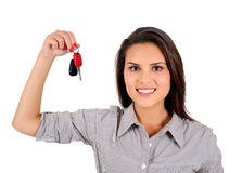 Isolated business woman. Isolated young business woman showing keys Stock Images
