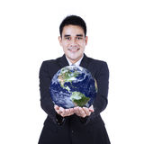 Isolated businessman holding a globe Stock Images