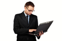 Isolated businessman with laptop Royalty Free Stock Photography