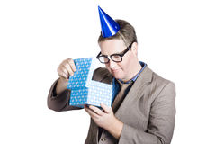 Isolated businessman in party hat. Business bonus Stock Image